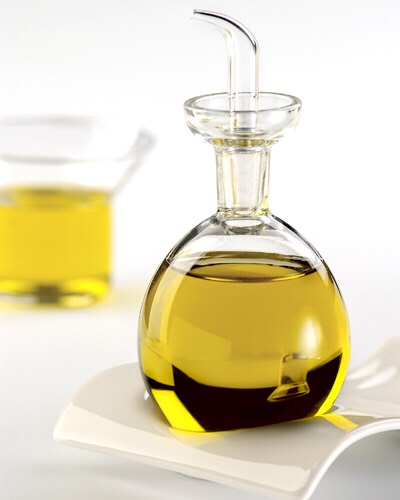 Place 1/2 cup of olive oil into microwave for 30 seconds.