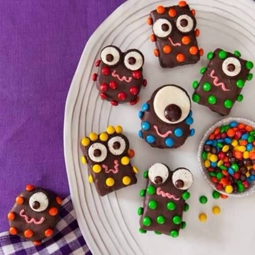 CLICK TO SEE FULL IMAGE  start of with your favorite brownie recipe. Let cool. Frost with chocolate frosting. Use open Oreo cookie and brown M&Ms for the eyes, M&Ms for body decoration, squeeze frosting for the mouth and whatever other candies you want to make your monster all your own!
