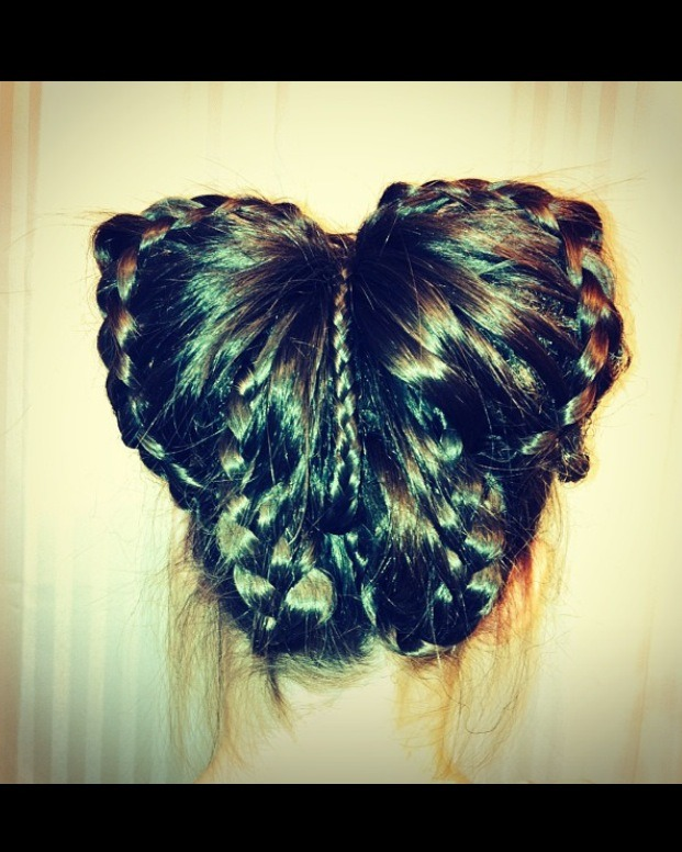 Pull hair into a ponytail Make four sections (and a small 5th for the butterfly body) pin two up and two down Then lace braid each section  Pinning each section like shown in picture  Use last 5th section as body of butterfly
