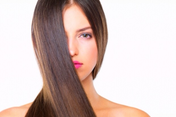 A tiny dab rubbed on your hands and then through hair will help get rid of friz