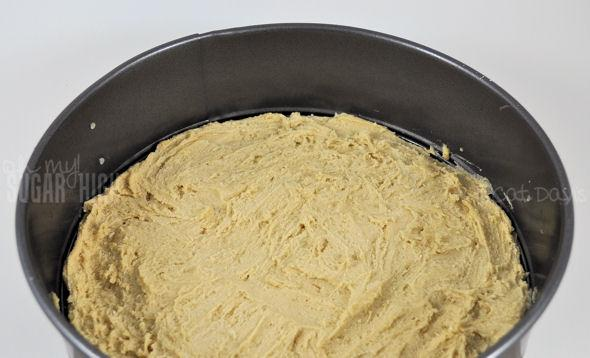 3. Using a (ungreased) 10 Inch Springform Pan, spread the cookie dough evenly across the base. Bake for 13 minutes and remove.