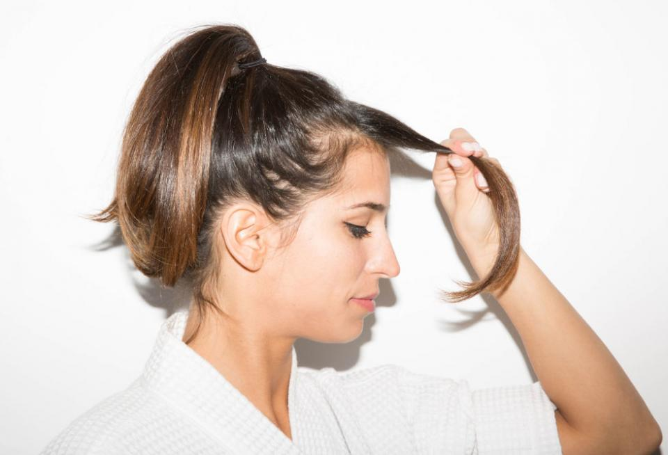 12. If the front pieces of your hair are greasy but the rest of your strands aren't, pull the back section of your hair out of the way and wash only the front section in the sink.
