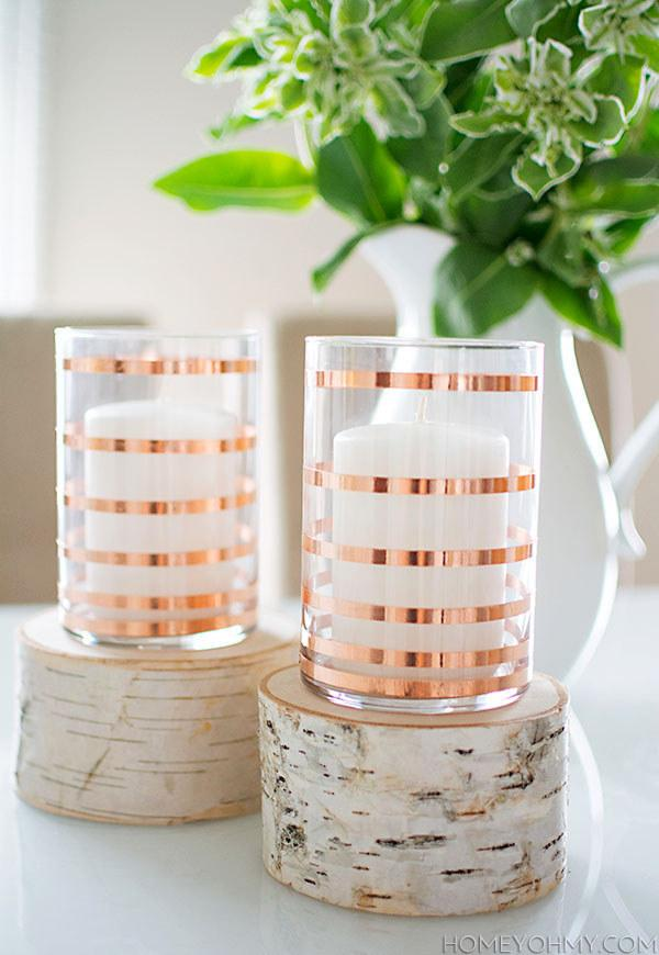 12. These simple copper striped candle holders.  http://www.homeyohmy.com/diy-copper-striped-candle-holders/?crlt.pid=camp.bqMN7UUnrtKh