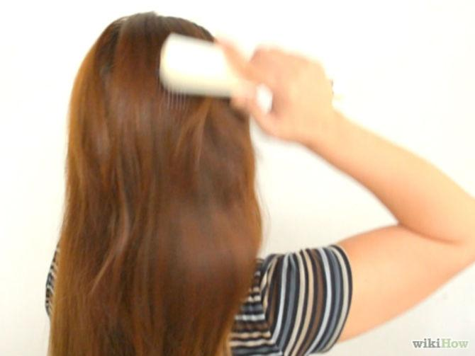 1. Pull your hair to the side you want your chignon to be on. The side you choose is up to you.