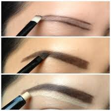 Step 3 add brown liner to define the arches of your brows and highlight with a light color under your brow bone and blend it in to add and extra lift