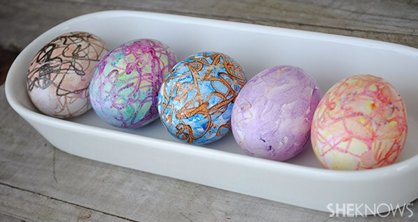 Because of the hot exterior of the egg, the crayon will melt on the egg's surface. Once your masterpiece is finished, gently place the egg into the original egg holder and place it in the refrigerator. After a few minutes, the eggs will be cool and can be handled and displayed as you'd like.