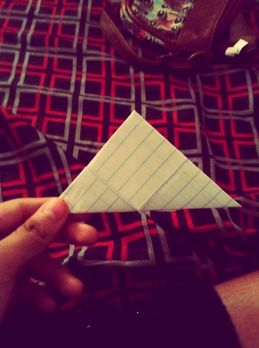 6) Fold it in half diagonally...