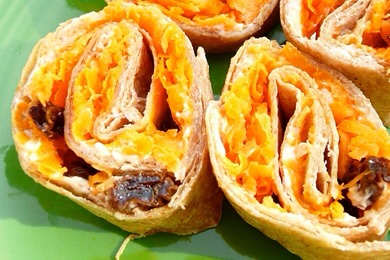 Spread cream cheese on tortilla. Add grated carrots and raisins and roll up. Slice into 10 pieces and enjoy!