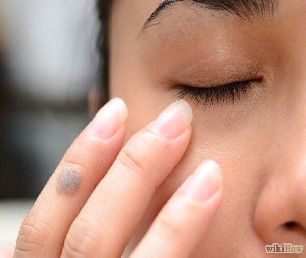 Do a mini-massage, sweeping inward through the ocular bone.It's relaxing and it helps to reduce that puffiness as well. The skin is very delicate in this area, so use your middle finger as it has the least amount of pressure.
