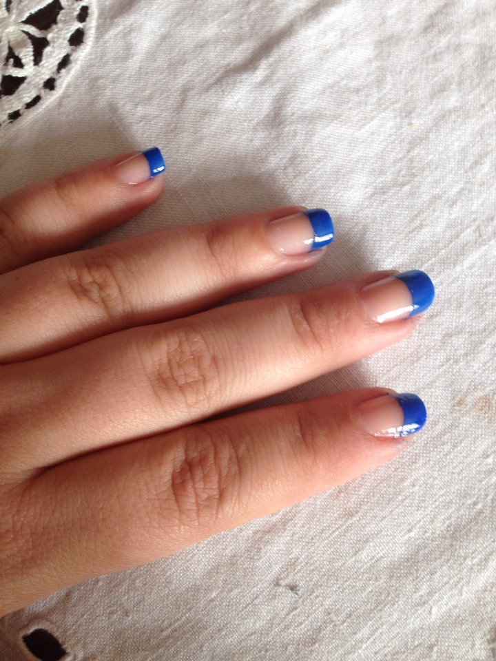 Start by doing a blue french tip, i like to paint the tip of my nail messy then clean up and create the curve using a brush