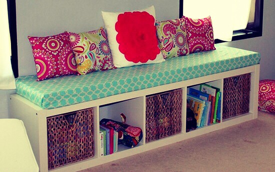 Use an old bookshelf turned on it's SIDE…. add long foam cover pad. add pillows and you have a window seat.