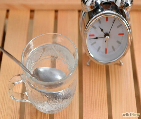 Leave the spoon in the cup of cold water for about 3 minutes or so.