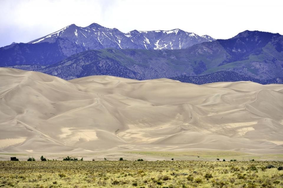 Great Sand Dunes National Park—the park contains the tallest sand dunes in North America, rising about 750 feet from the floor of the San Luis Valley. Research says the dunes started forming less than 440,000 years ago from sand and soil deposits of the Rio Grande and its tributaries.