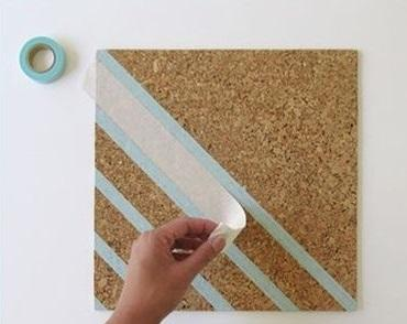 STEP 1: Cut out some shapes or designs ffrom the washi tape and stick them on the corkboard tiles.  You're done!