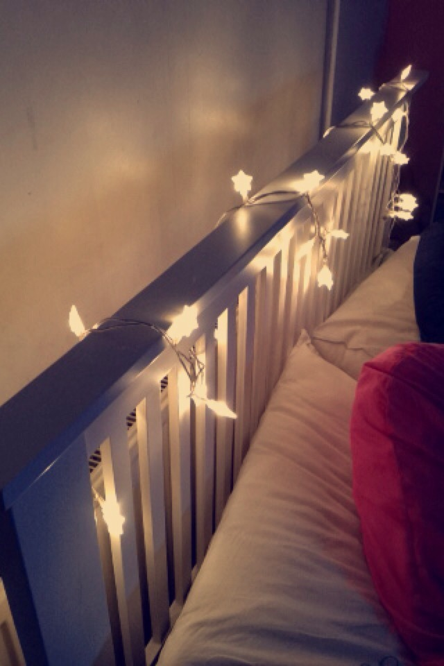 Wrap fairy lights around a bed post for an instant cute and cosy touch