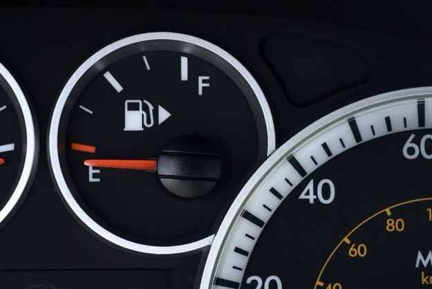 The little arrow on your gas gauge is there to tell you what side your gas tank is on. Helps while driving rental or somebody else's car