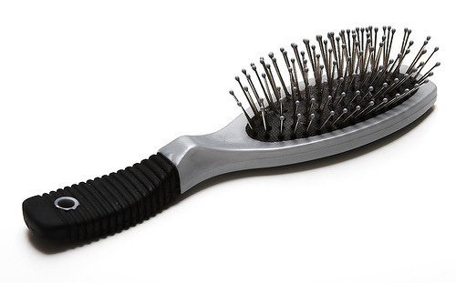 Lightly mist your hair brush with perfume to make your hair smell good (don't use near scalp)
