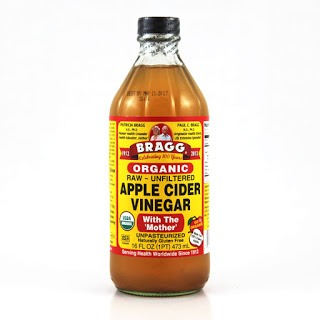 Apple cider vinegar may sound weird, but if you put it in a spray bottle with water and put it on your hair with shampoo, it's proven to get rid of dandruff and make your hair 'alive' and let blood flow through for growth. I prefer braggs because it's natural but you can use any kind.