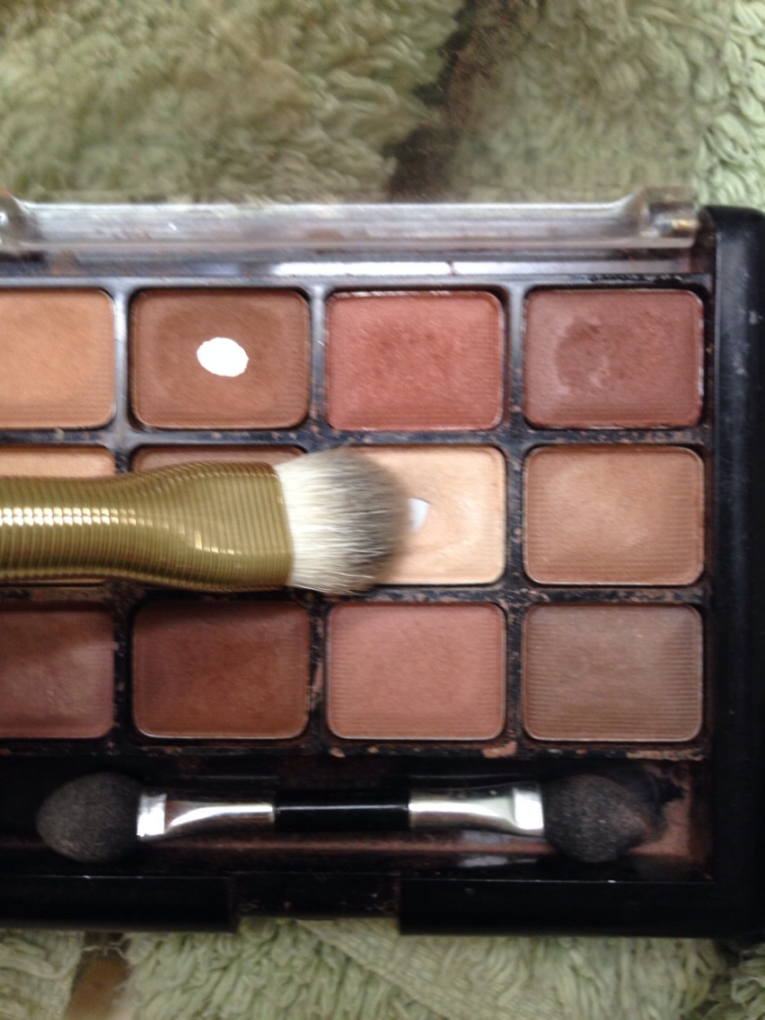 Now you will use your large shadow brush and a light shadow to highlight your brow bone.