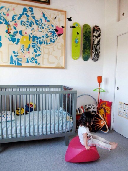 Keep the Decor  This nursery may not scream baby but its art filled walls and personality will remain classic through the years.