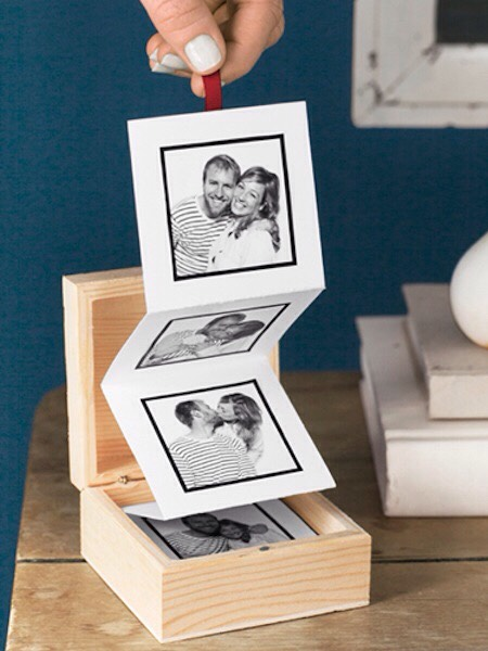 "11. Pull-Out Photo Album A great alternative to your traditional photo album! You can buy those little wooden boxes online, but they are also available at craft stores like Hobby Lobby. The rest is made with card stock and photos. I would call it a ""memory box""."