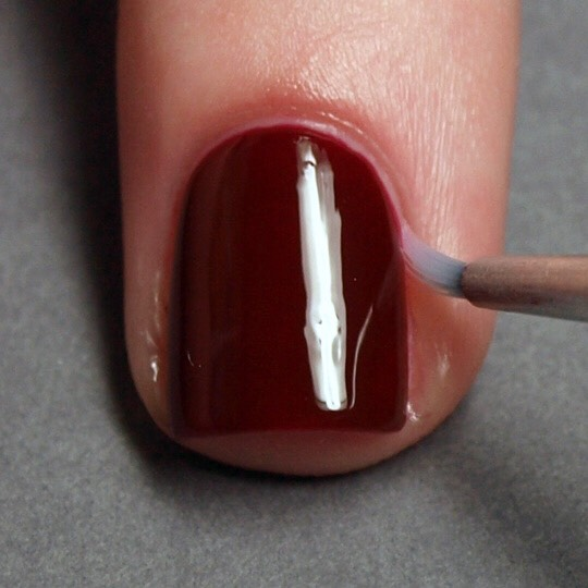 * Use a small paintbrush to clean up your manicure. Just dip the brush in nail polish remover and then swipe your cuticles for a fresh look. Plus, it won't leave any unwanted hairs behind like a cotton swab would.