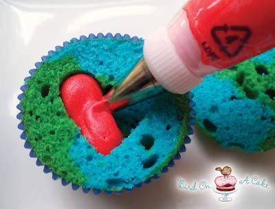 Fill the heart-shaped cavity with red frosting