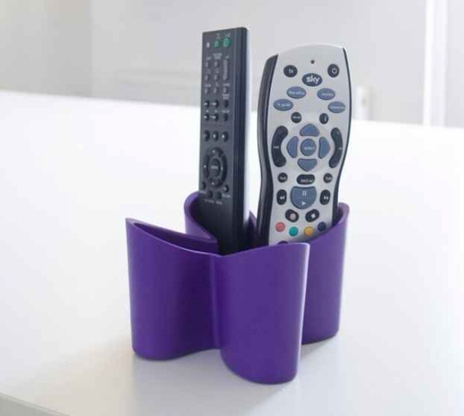 Remote control caddy. Finally, something besides a basket. ($19)  https://m.fancy.com/things/615742999405532890/Cozy-Remote-Tidy-by-J-ME