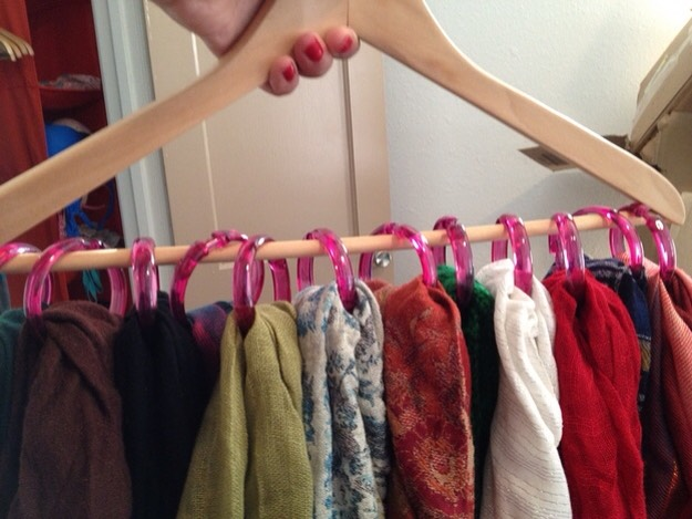 9. Too many scarves? Use shower curtain rings to organize them on a hanger.