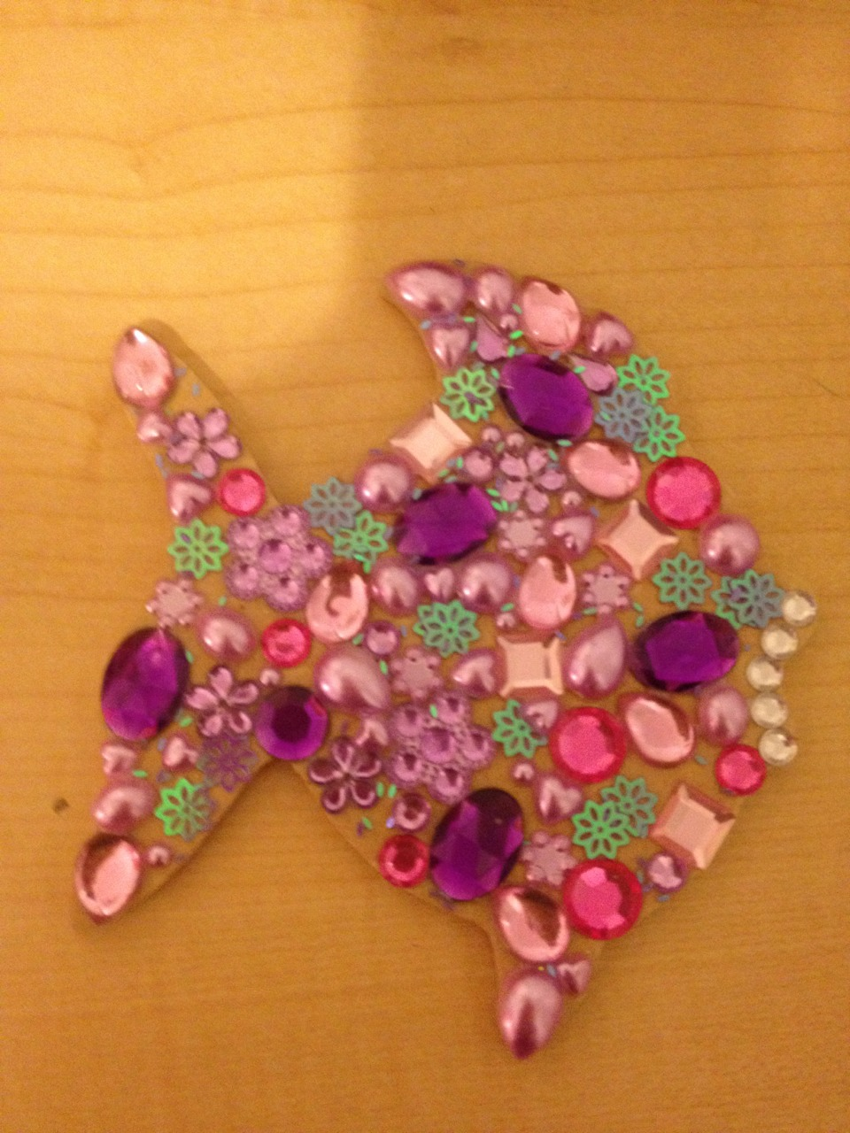All you need is a wooden shape and some gems. Simply cover you woodenly shape with glue and cover it with your gems! This DIY is super girly and fun!