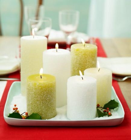Sparkly candles  Add homemade sparkle to your candle centerpieces. Coat candles with Mod Podge, then roll in epsom salt for a sparkly, snow-covered effect. Arrange on a tray filled with more epsom salt and finish with a few sprigs of holly or other greens.