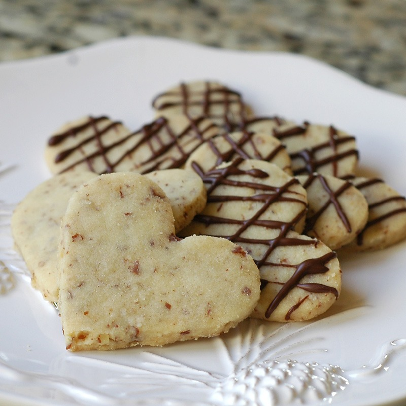 Cut into rounds or fingers and place onto a baking tray. Sprinkle with caster sugar and chill in the fridge for 20 minutes. Bake in the oven for 15-20 minutes, or until pale golden-brown. Set aside to cool on a wire rack. You can also ice, decorate, add chocolate chips and shape your shortbread!