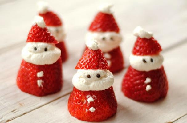 """Slice a strawberry 2/3 of the way and then add whipped cream between the 2 slices and a little dot on top for the """"poof"""" of the hat. Add 2 little sprinkles for the eyes"""