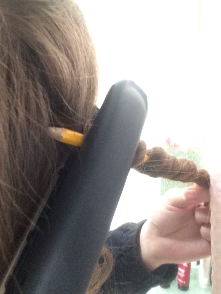 Once you have wrapped your hair around you need to place the hair straighteners over the part of hair you wish to curl do this for about 20 seconds