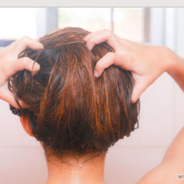 STEP 5. Apply honey mixture around the roots of the hair that you've clipped up. Use a comb to apply through the layers of your hair and massage from root to tip. Pin up hair as you finish each piece.