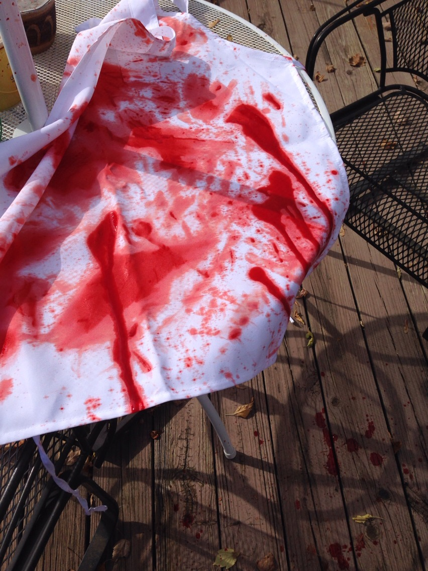 I bought a cheap apron and shirt to complete the look. Add fake blood and layers of dirt to make it look extra gross.  Originality is always the key and have fun!
