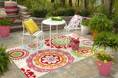 Colorful Rugs Make your front porch a bit cozier by getting an outdoor rug. Green will compliment the foliage around your porch, oranges and yellows will brighten the space, while blues will soothe. For an affordable options, check outIKEA'sselections.
