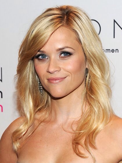 FOR HEART FACES: DEEP SIDE PART With long hair, start with a clearly defined side part, then add side-swept bangs.