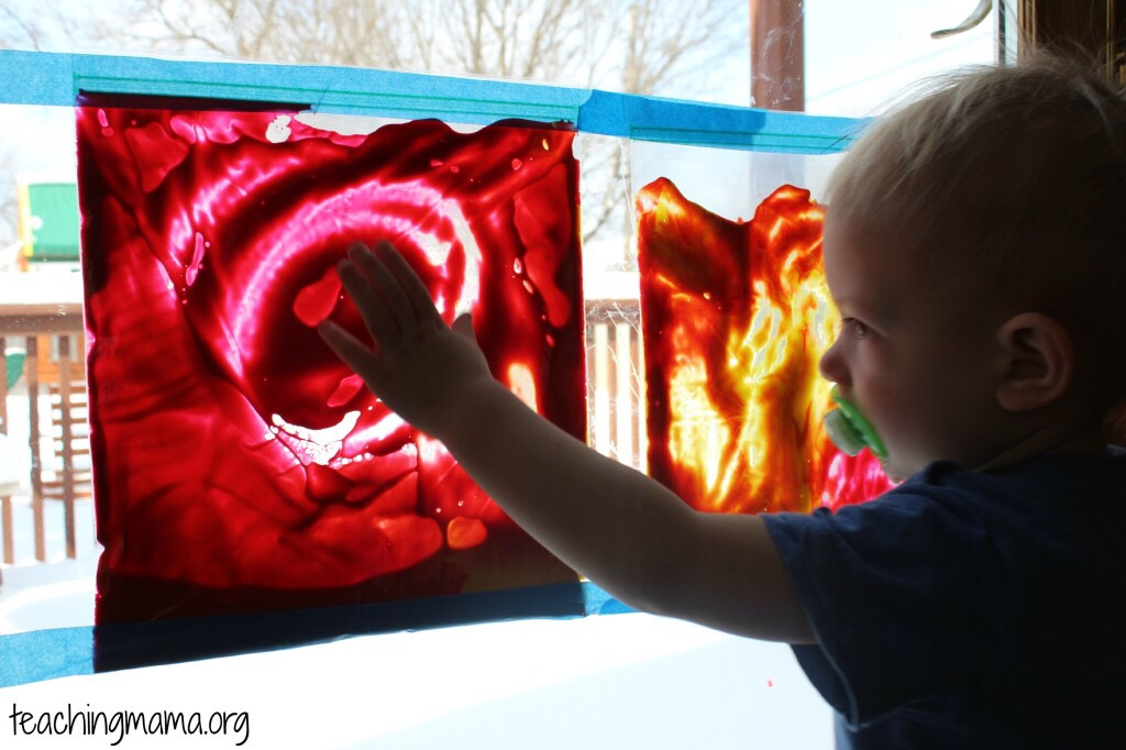 Tape a ziplock bag filled with paint against a window and let the child just have fun