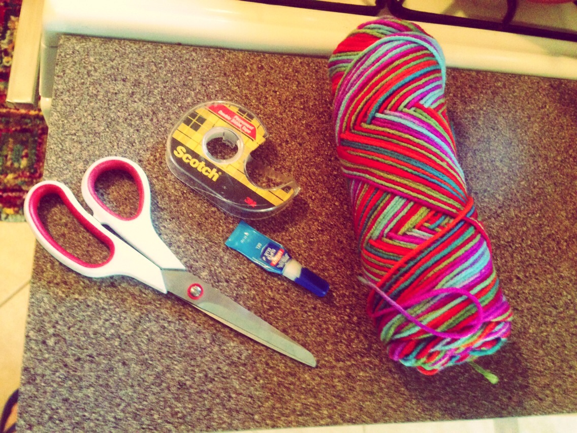 Here's what you'll need! Pick up some yarn of your choice, super glue, thin double sided tape and scissors.