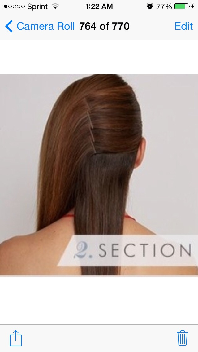 Separate your hair into three sections—one in the back and two on either side—and pin one section back in the middle of your head.
