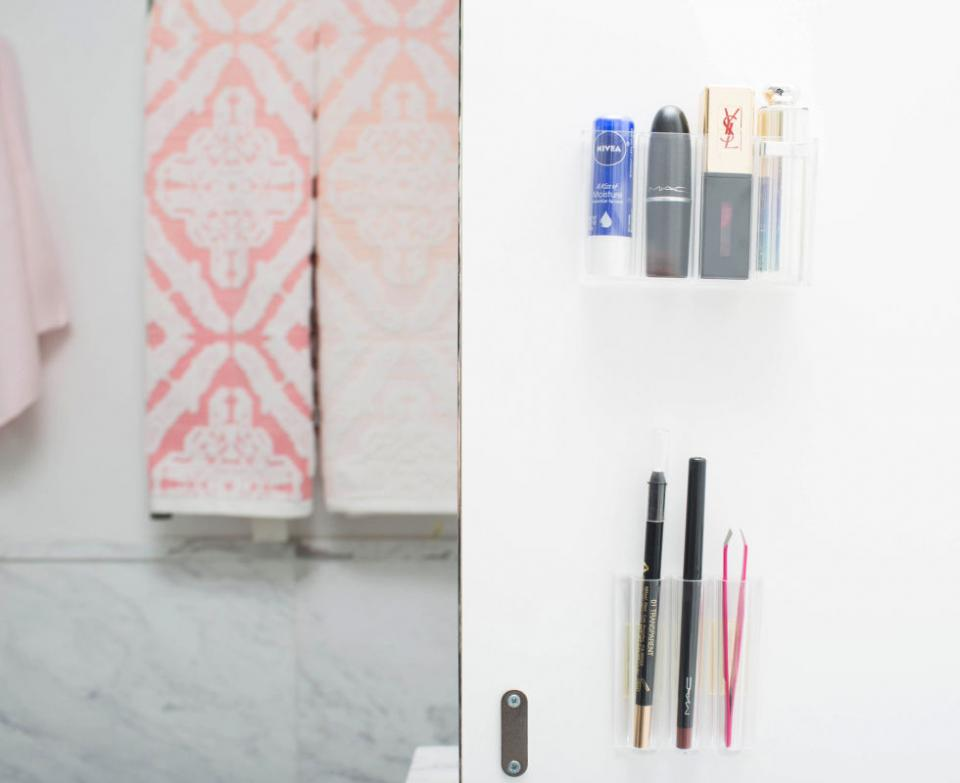 13. Stick adhesive wall organizers inside your medicine cabinet to store small, hard-to-find products. The smaller the product, the easier it is to lose in the abyss that is your bathroom cabinet. With these wall organizers, your lip balm will always be right where you left it.