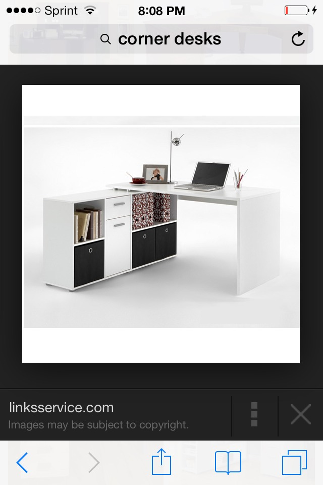 Get a desk that will help declutter and look nice in the space you want.