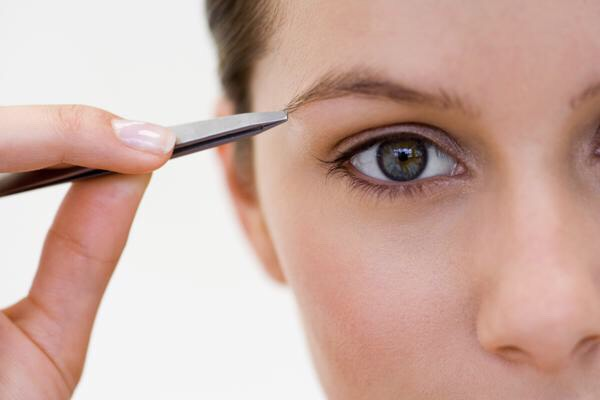 12. Use a white eyeliner to mark stray hairs and then just pluck the white ones!