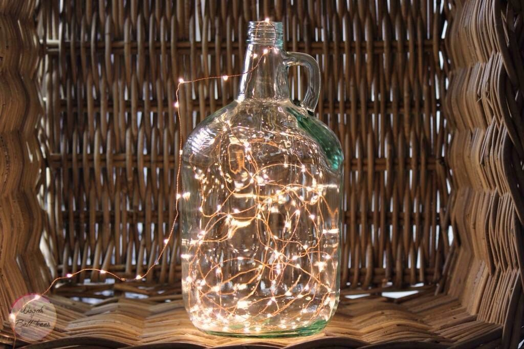Got an old glass jug or glass bottles around? Fill them with lights!