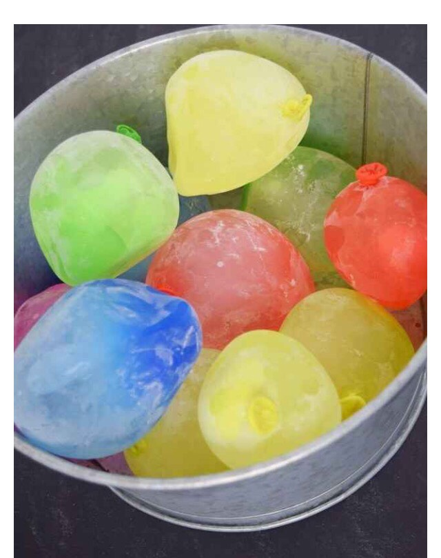 Place frozen balloons in cooler to prevent a meltdown