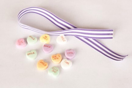 Gather Your Materials  Start by picking out a piece of ribbon and a handful of conversation hearts.