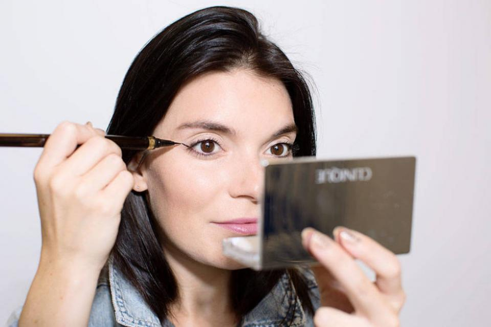 4. Keep your eyes open when creating the tail of your cat-eye, so you can see exactly how the flick will look with your eye open.