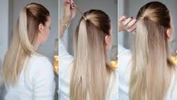 A classic hairstyle loved by many but why not take a small amount of hair and wrap it around your hair tye to clean the look up , don't forget to secure it with a bobby pin.