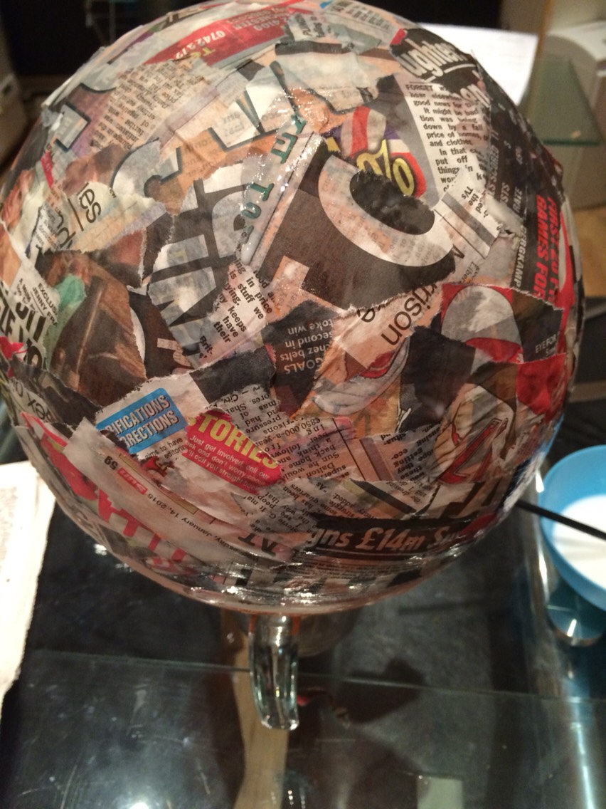 Once covered the balloon to the way you want it wait until dry do this step over and over until it is a thick newspaper balloon then pop the balloon it's should stay the shape it was paper mached